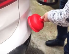 Fix Exterior Dents Using Hot Water and a Plunger