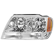 Driver Side Headlight, With bulb(s) - 99-04 Grand Cherokee (Limited/Overland Model)