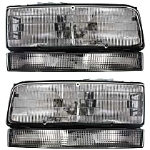 Driver and Passenger Side Halogen Headlight, With Bulb(s) - w/ Black Trim
